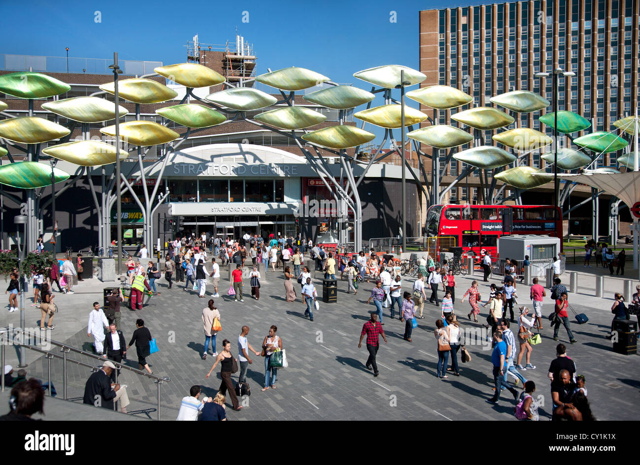 England. London. Crowds of people outside Stratford Shopping Centre showing the 'Stratford Shoal' sculpture. - Stock Image