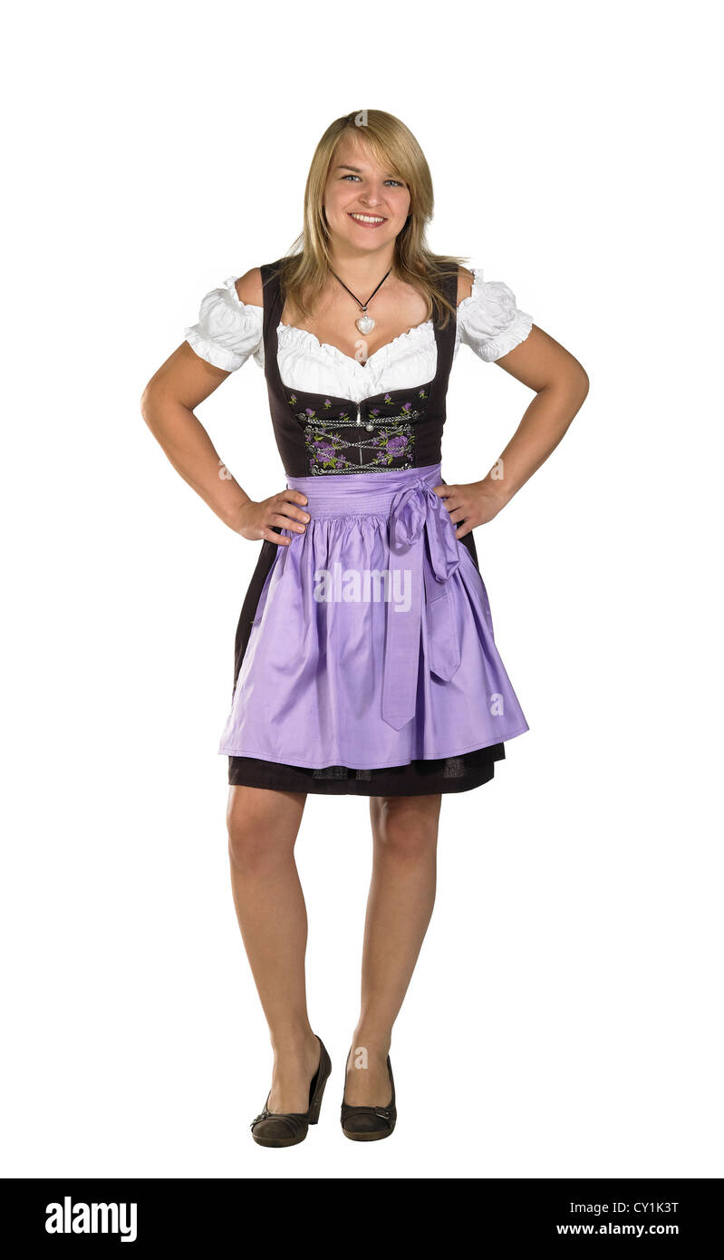 coquettish blond woman wearing a traditional dress named dirndl - Stock Image