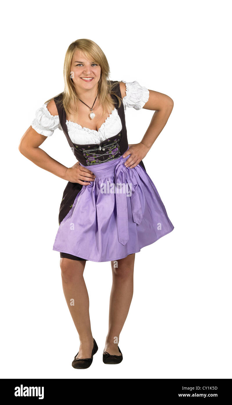 coquettish blond woman wearing a traditional dress named dirndl in white back - Stock Image