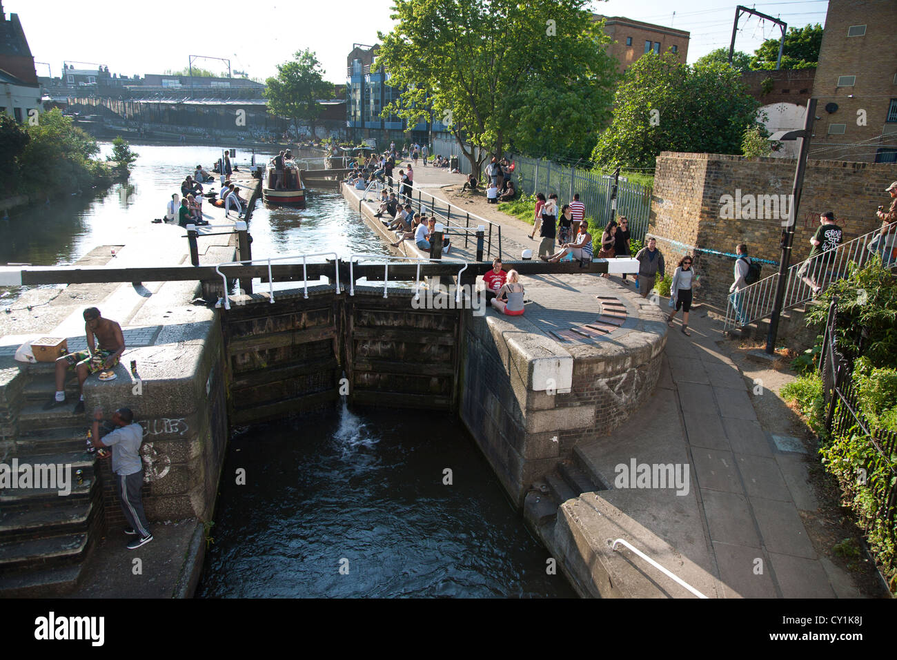 England. London. Camden Lock. People and Regent's Canal lock gates. - Stock Image