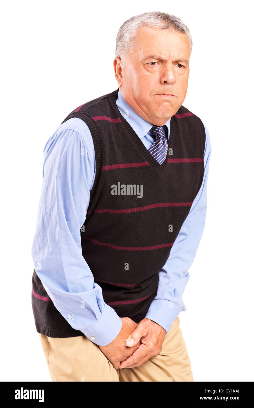 A senior man with bladder control problem isolated on white background - Stock Image