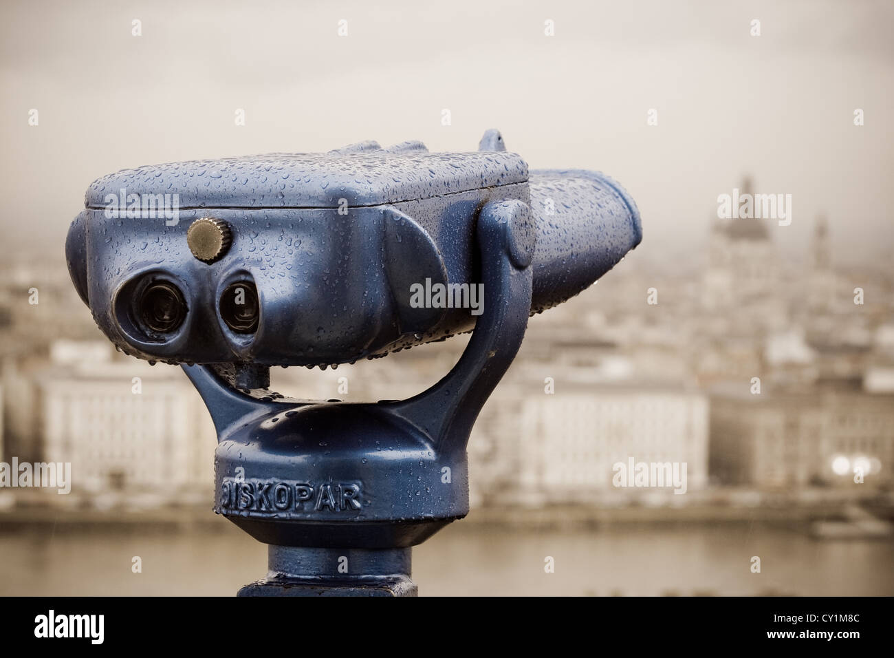 Blue binoculars in Budapest in a rainy day. - Stock Image