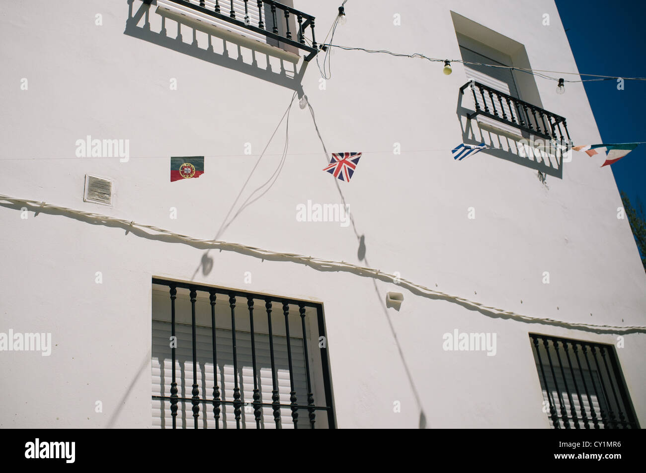 Portuguese An Spanish Flags Stock Photos Electrical Wiring In Hanging Between Houses The Small Hamlet Of La Toba Jaen Spain