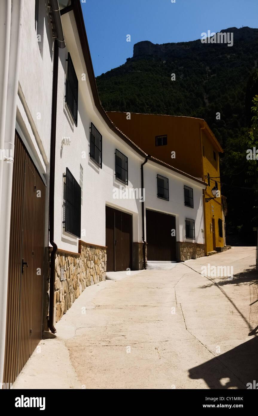 White houses in the small Spanish hamlet of La Toba in the Sierras de Cazorla, Segura y Las Villas Natural Park - Stock Image