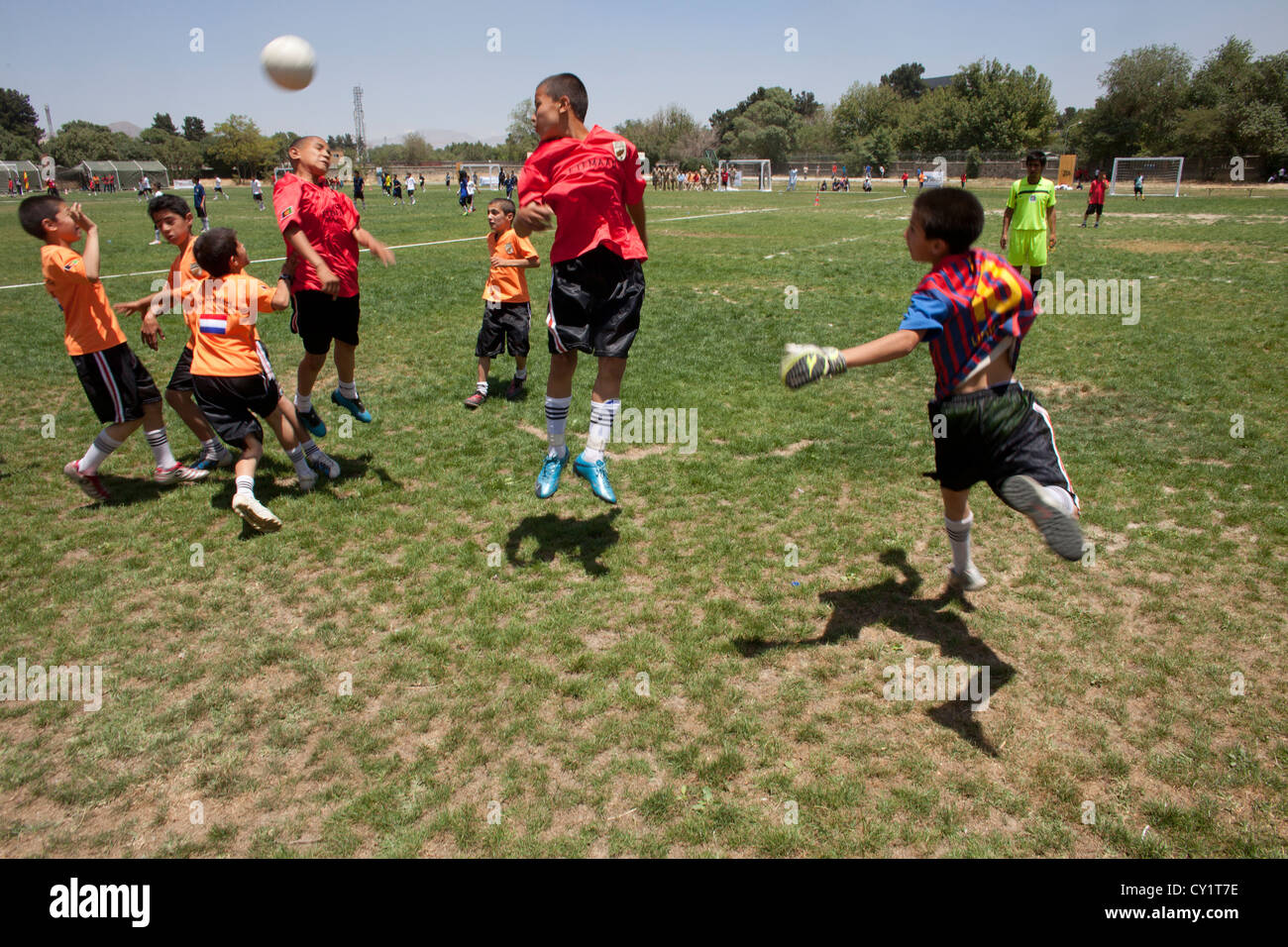orange ball kids world cup kabul. german army fiel - Stock Image