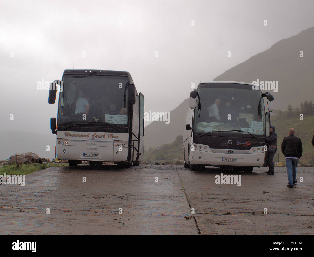Two tourism buses parked at killary Fjord in Connemara, at the entrance to the cataraman service  in the west of - Stock Image