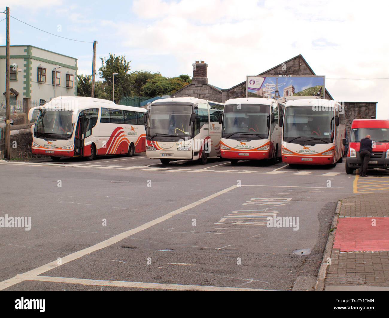 An assemblage of Irish Bus Eireann buses parked at Galway City train and bus station in the West of Ireland. - Stock Image