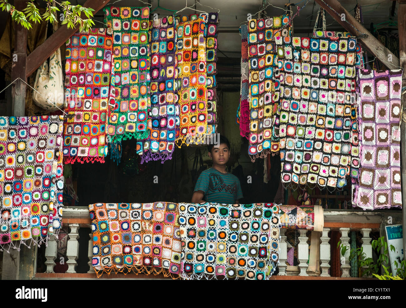 Crocheted textiles for sale at the market in Ubud, Bali, Indonesia - Stock Image
