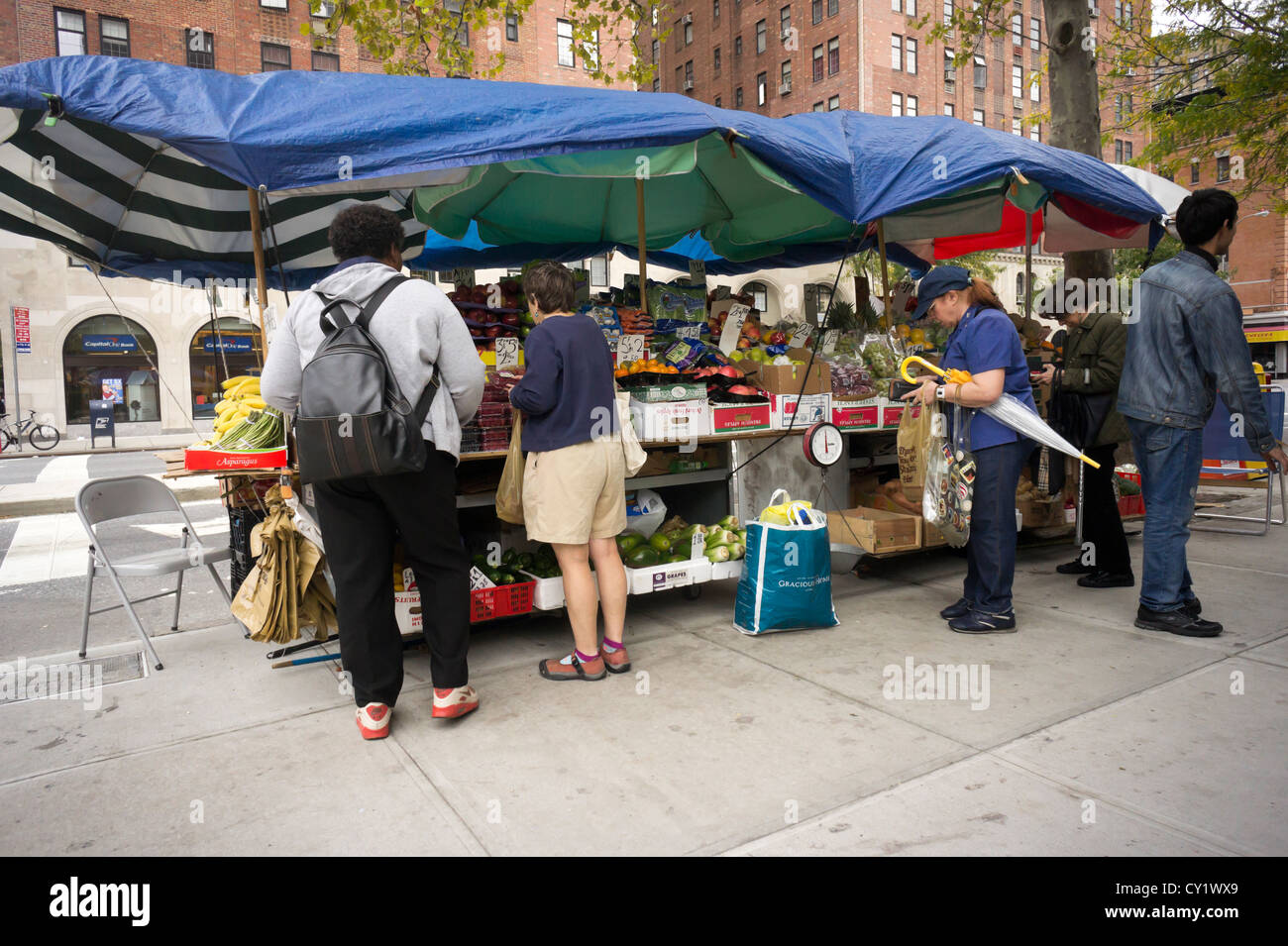A fruit and vegetable stand in the Chelsea neighborhood of New York on Monday, October 15, 2012. (© Richard B. Levine) Stock Photo