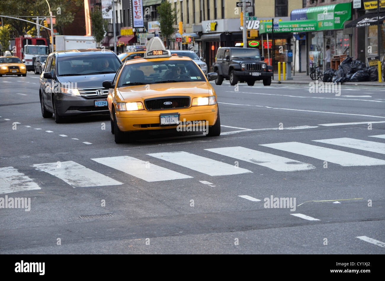 taxicab driving in New York City - Stock Image