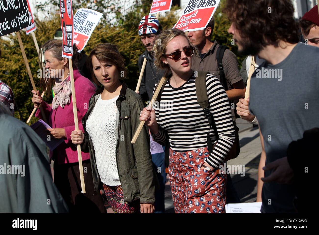 Protesters pictured during a protest against Government cuts in Brighton, East Sussex, UK. - Stock Image
