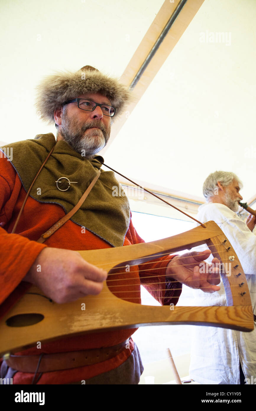 Musicians play during a gathering of an old Norse gods religious sect in Thingvellir in Iceland. - Stock Image