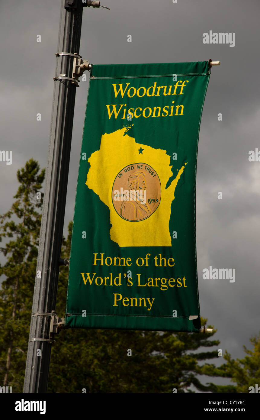 Welcome to Woodruff sign in Woodruff, Wisconsin, Home of the World's Largest Penny. - Stock Image