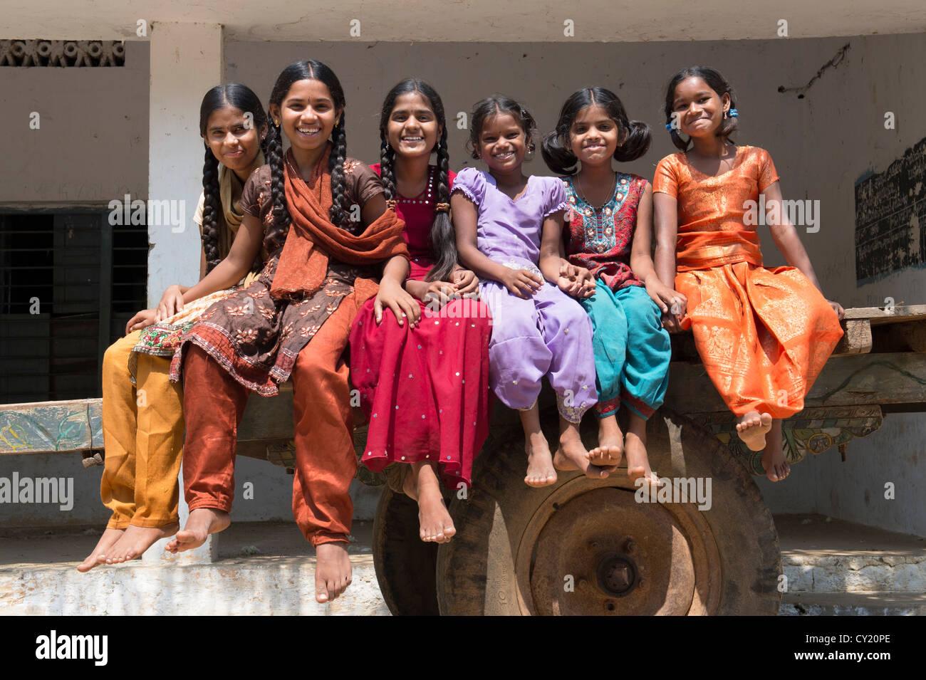 Rural Indian village girls on a bullock cart. Andhra Pradesh, India Stock Photo
