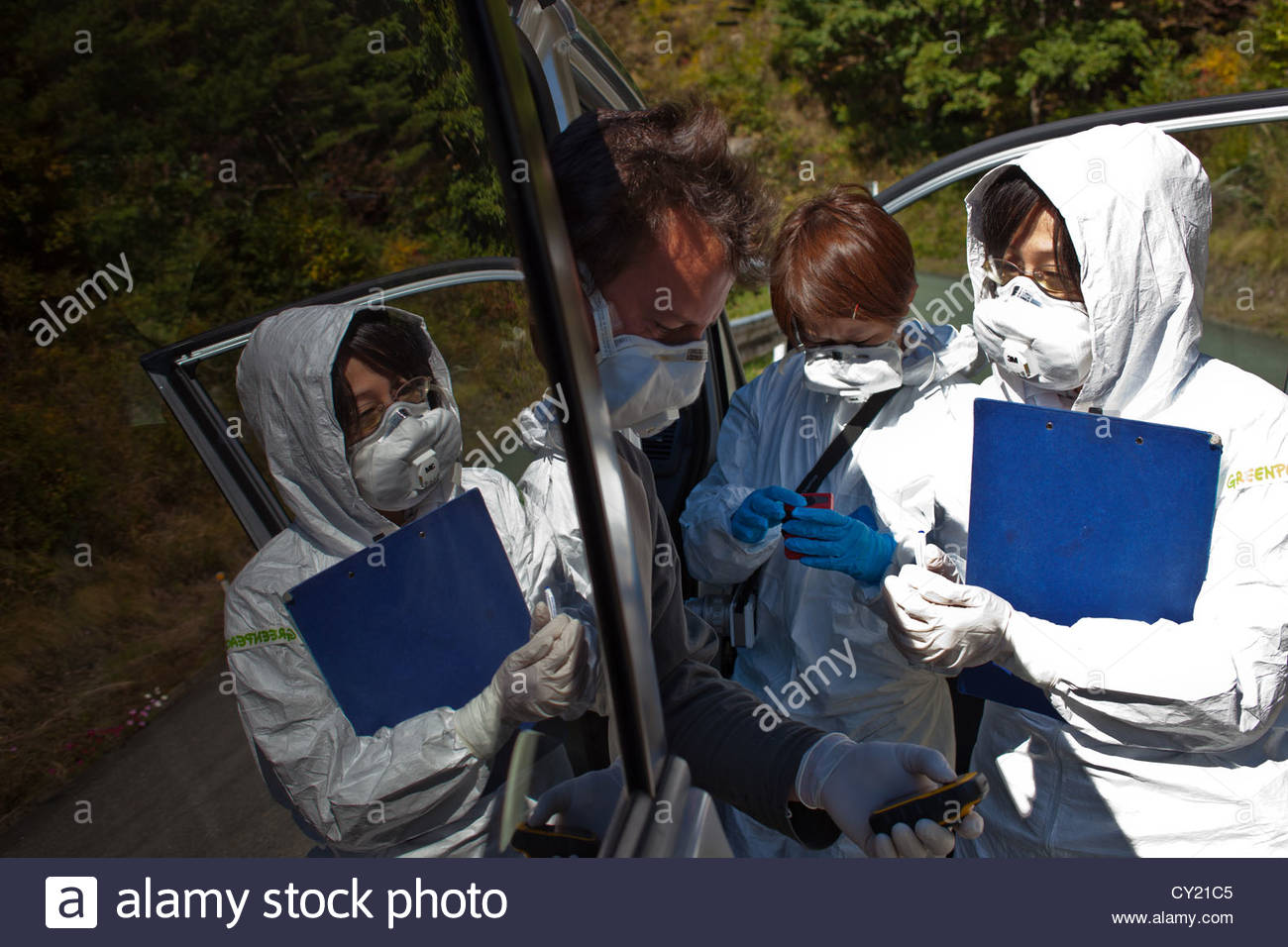 A Greenpeace radiation monitoring team checks contamination levels in Iitate. - Stock Image