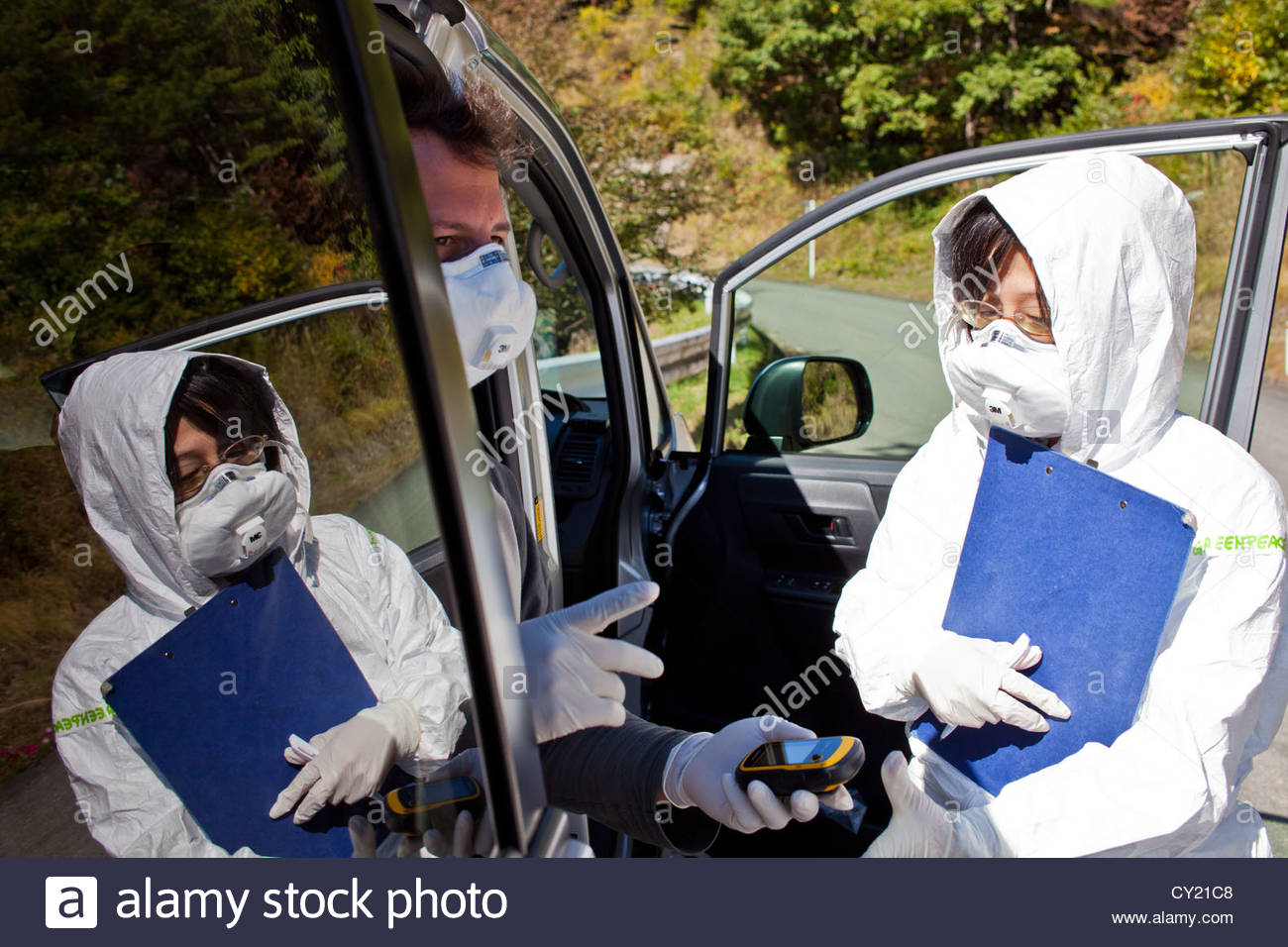 A Greenpeace radiation monitoring team checks contamination levels in Iitate - Stock Image