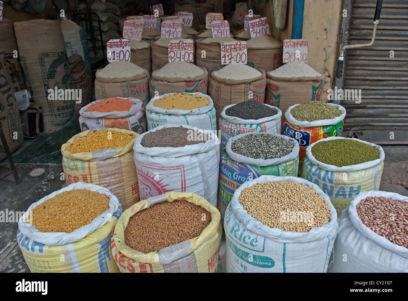 A variety of pulses in sacks displayed in a grocer's store in India. - Stock Image