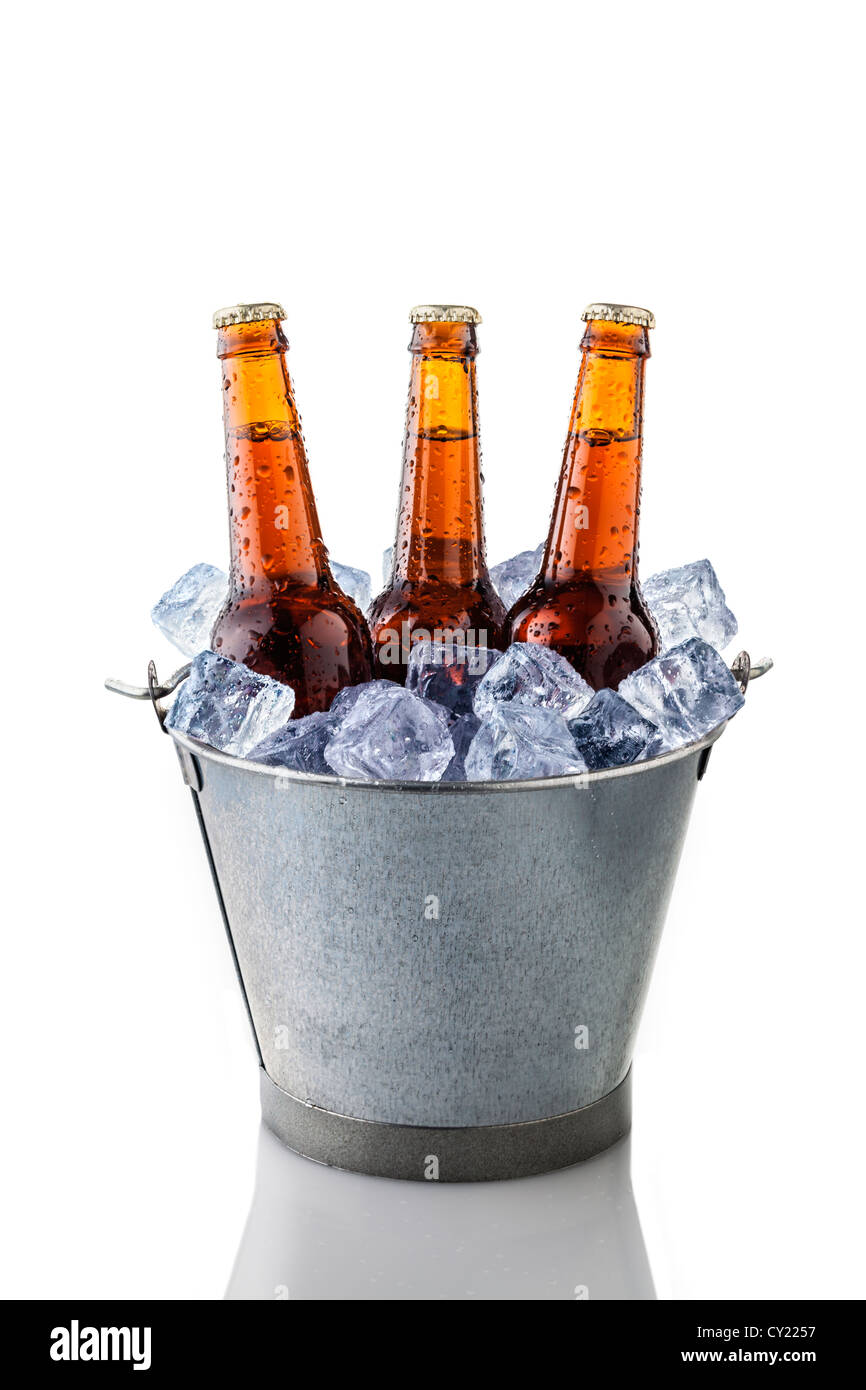beer bottles in a bucket of ice isolated on white background - Stock Image