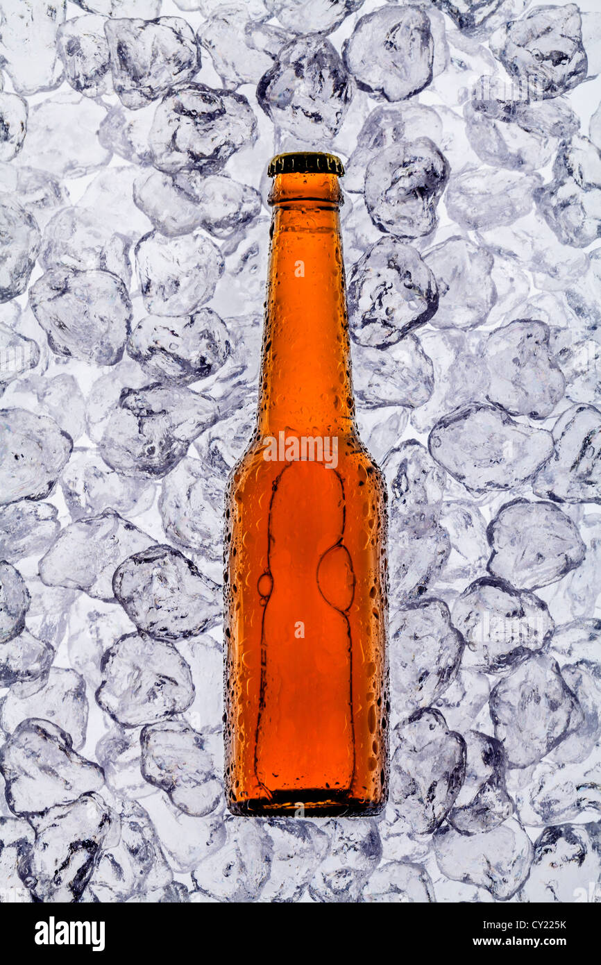 beer on ice cubes fragmented in horizontal - Stock Image