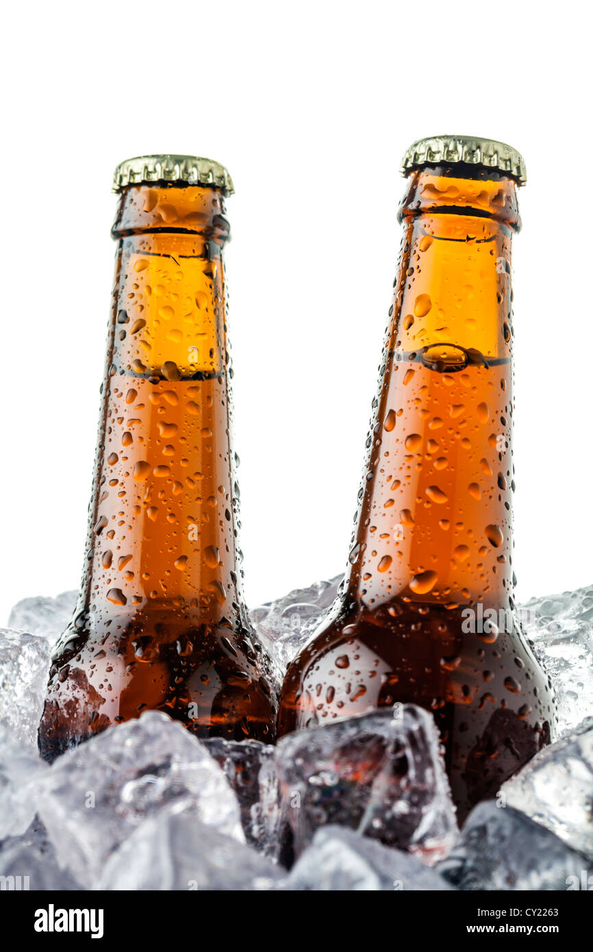 beers on ice cubes whit water drops - Stock Image