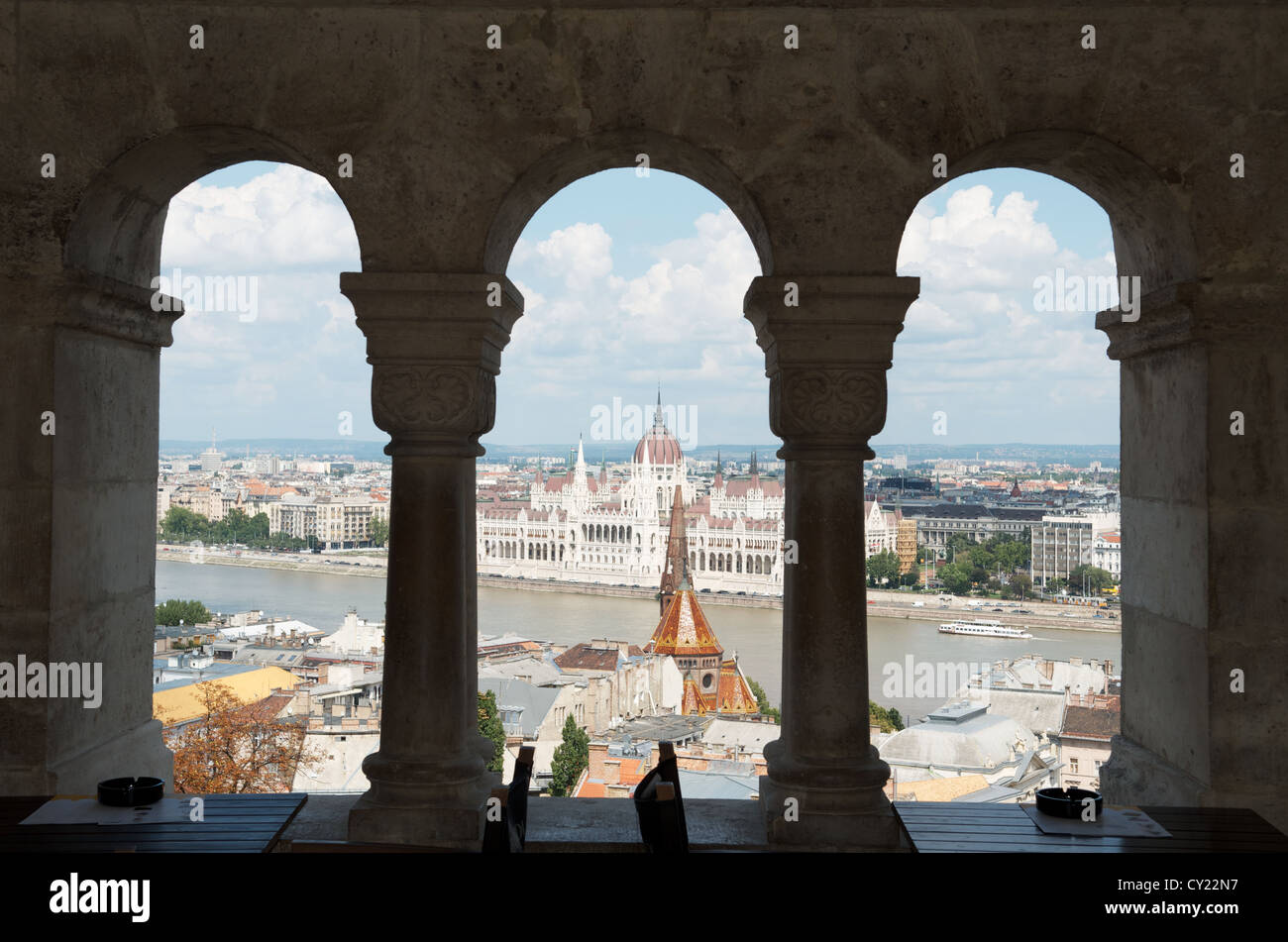 Hungarian Parliament building seen through the arches of Fisherman's Bastion on Castle Hill in Budapest, Hungary Stock Photo