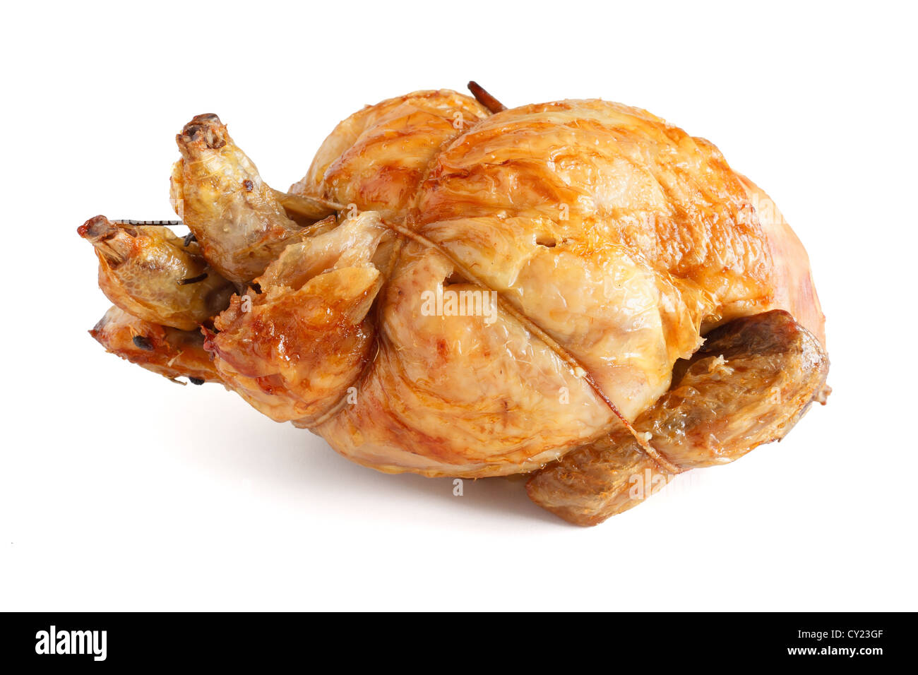 whole roasted chicken over white background - Stock Image