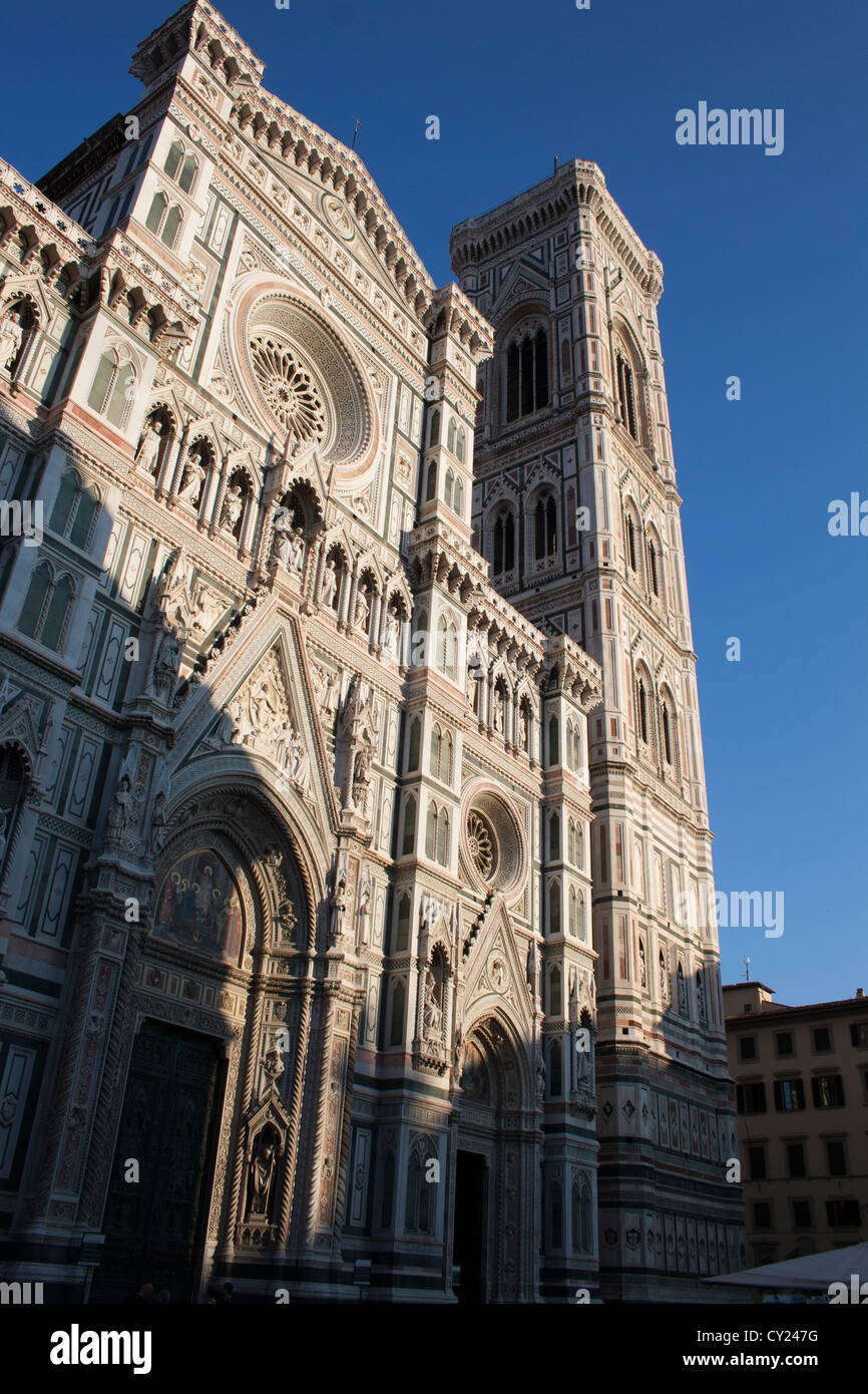 The facade of the famous Cathedral also known as the Duomo in the historic centre of Florence at sunset - Stock Image