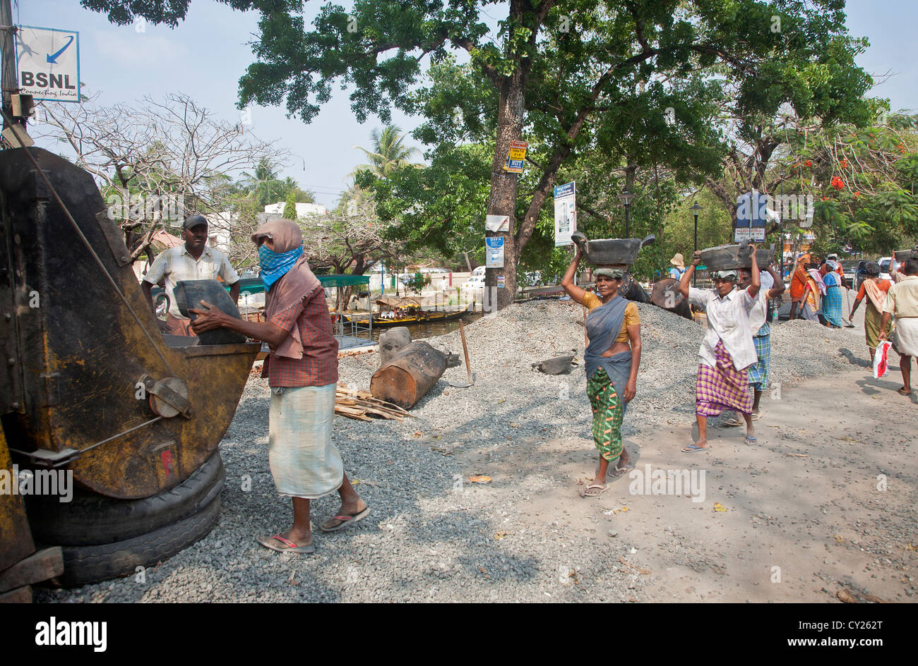 Women at work (building a road). Alleppey. Backwaters. Kerala. India Stock Photo