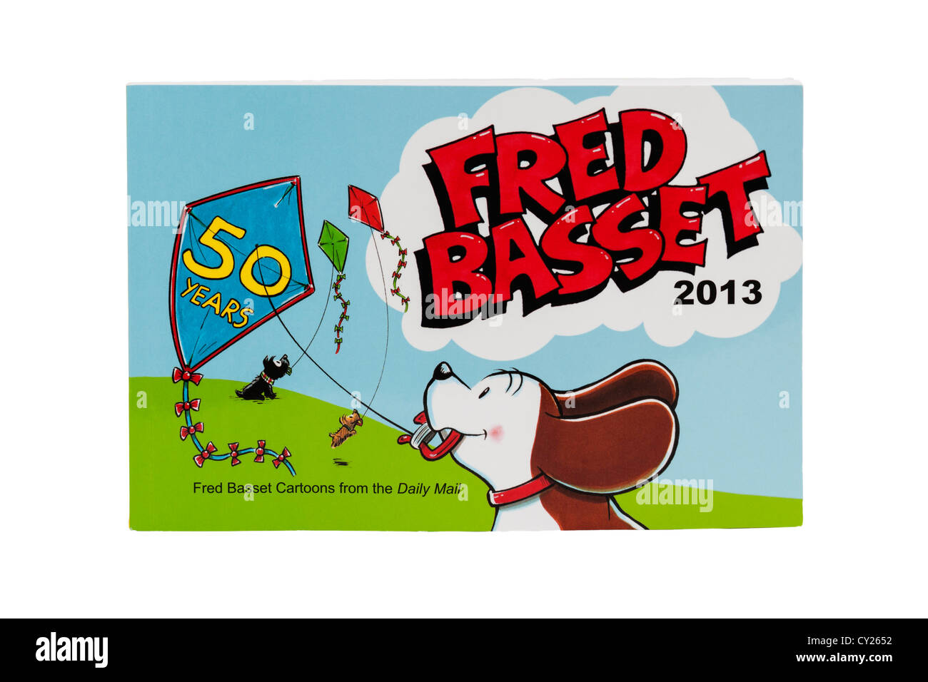 A 2013 Fred Basset book celebrating 50 years of Fred Basset cartoons on a white background - Stock Image