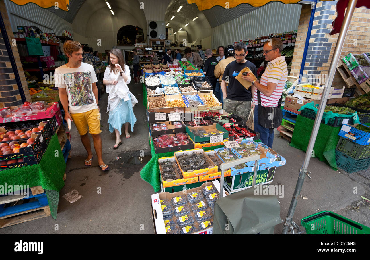 Customers at a greengrocer's shop on Druid Street, London, SE1, England, UK - Stock Image