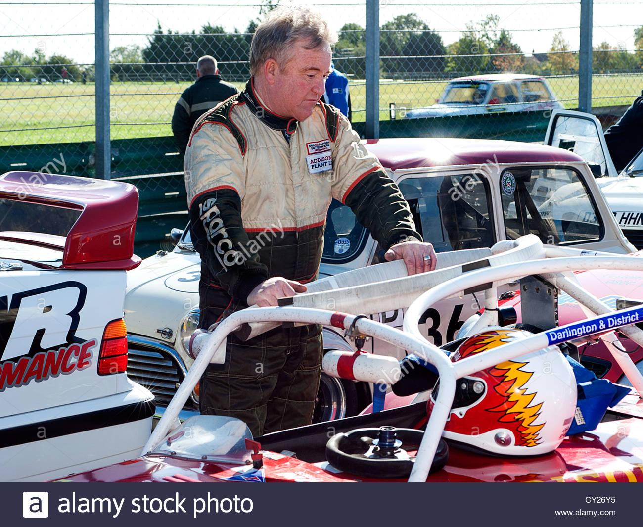 Bill Addison, North East Saloon Car Championship winner at Croft Circuit Darlington in 2012,stood next to his Caterham - Stock Image