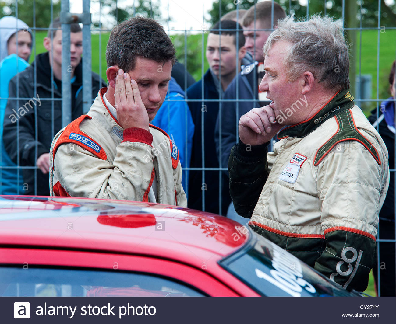 2012 British Saloon car champion, Bill Addison planing the next race with his son Martin who went on to win his - Stock Image