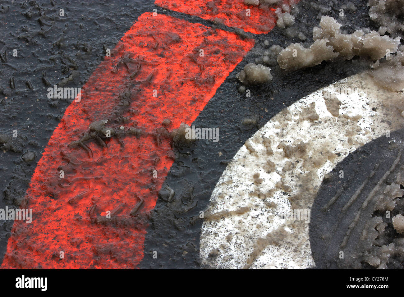 road ground signs, mushy, snow, icy dirty roads, bad weather, winter snowy bad road conditions, photoarkive - Stock Image