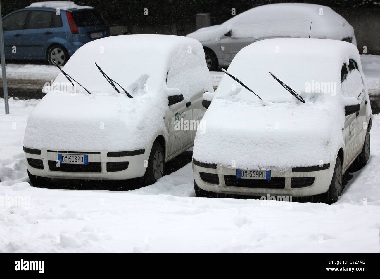 two identical cars cover in snow, winter, winter roads, parking, traffic in bad weather, photoarkive - Stock Image