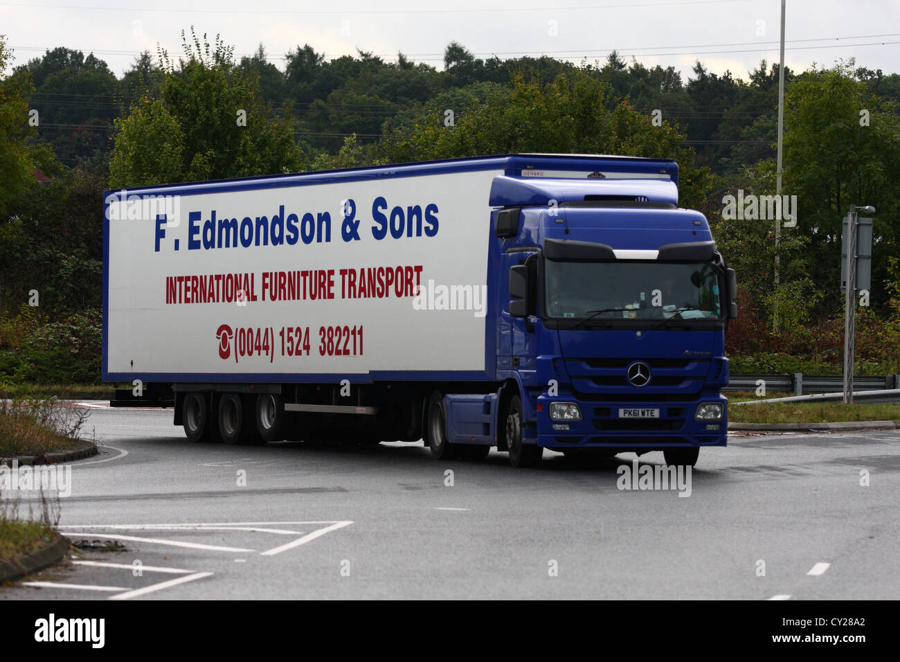 A 'F Edmondson' truck traveling along a road in England - Stock Image