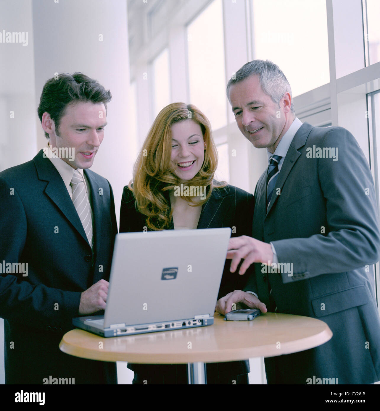 business people man woman confidence cooperation laptop notebook License free except ads and outdoor billboards Stock Photo