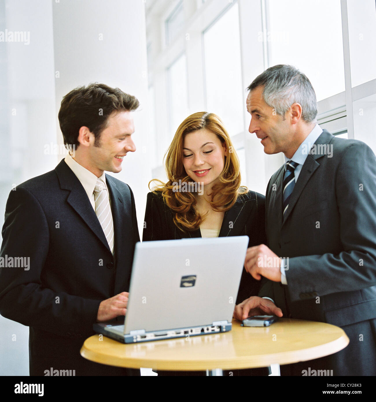 business people man woman confidence cooperation laptop notebook License free except ads and outdoor billboards - Stock Image