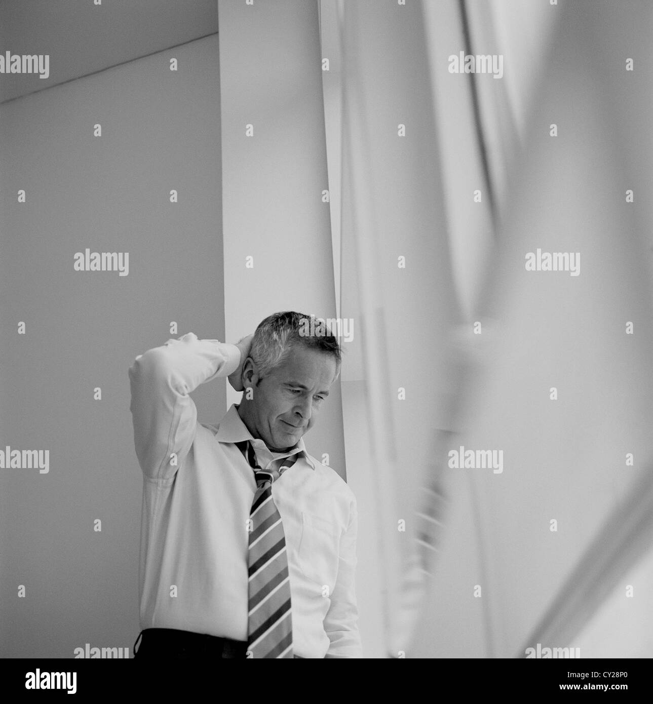 black and white business man frustration stressed businessman License free except ads and outdoor billboards Stock Photo