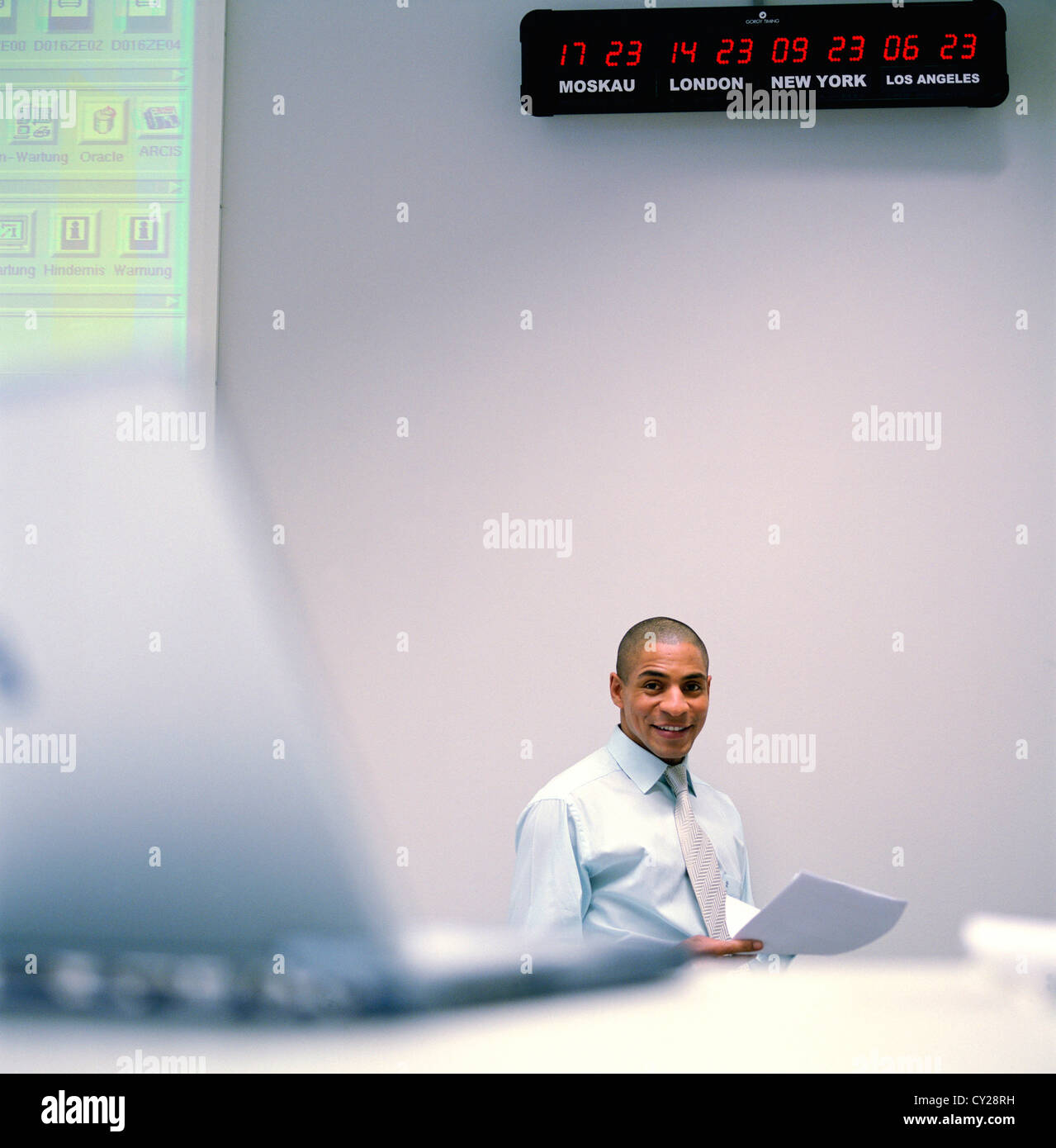 business people data center control center man desk world clock License free except ads and outdoor billboards Stock Photo