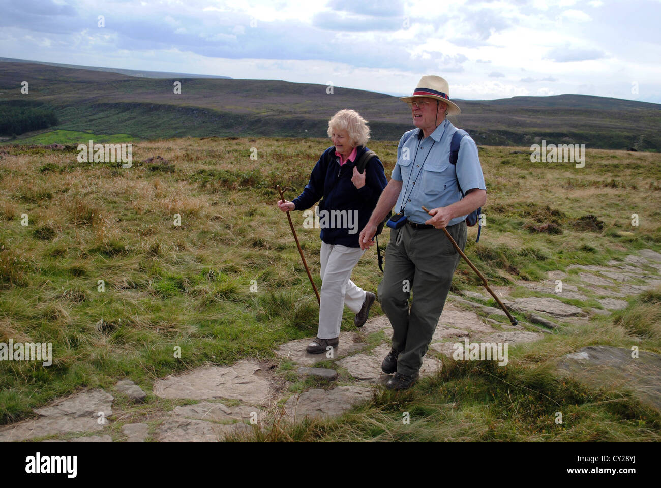 Husband and wife hiking at the Wainstones, cleveland hills. - Stock Image