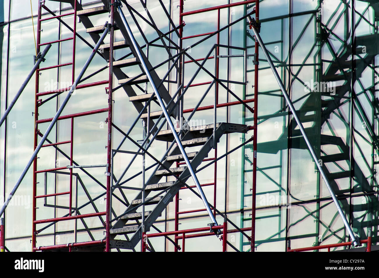 Scaffolding reflected on a new glass building - Stock Image