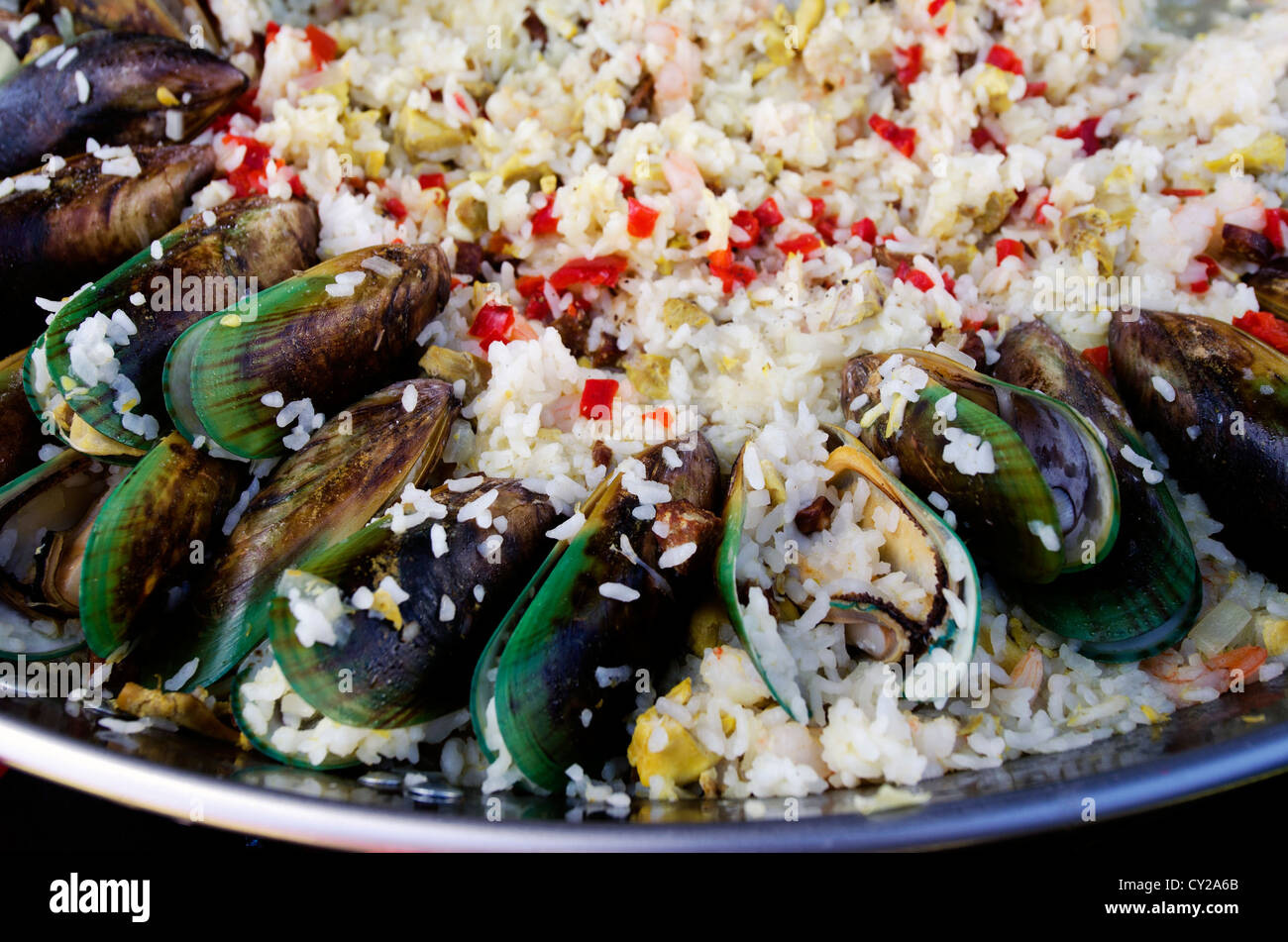 Cooked Oysters with vegetables and oriental fried white rice on display in a far eastern restaurant. - Stock Image