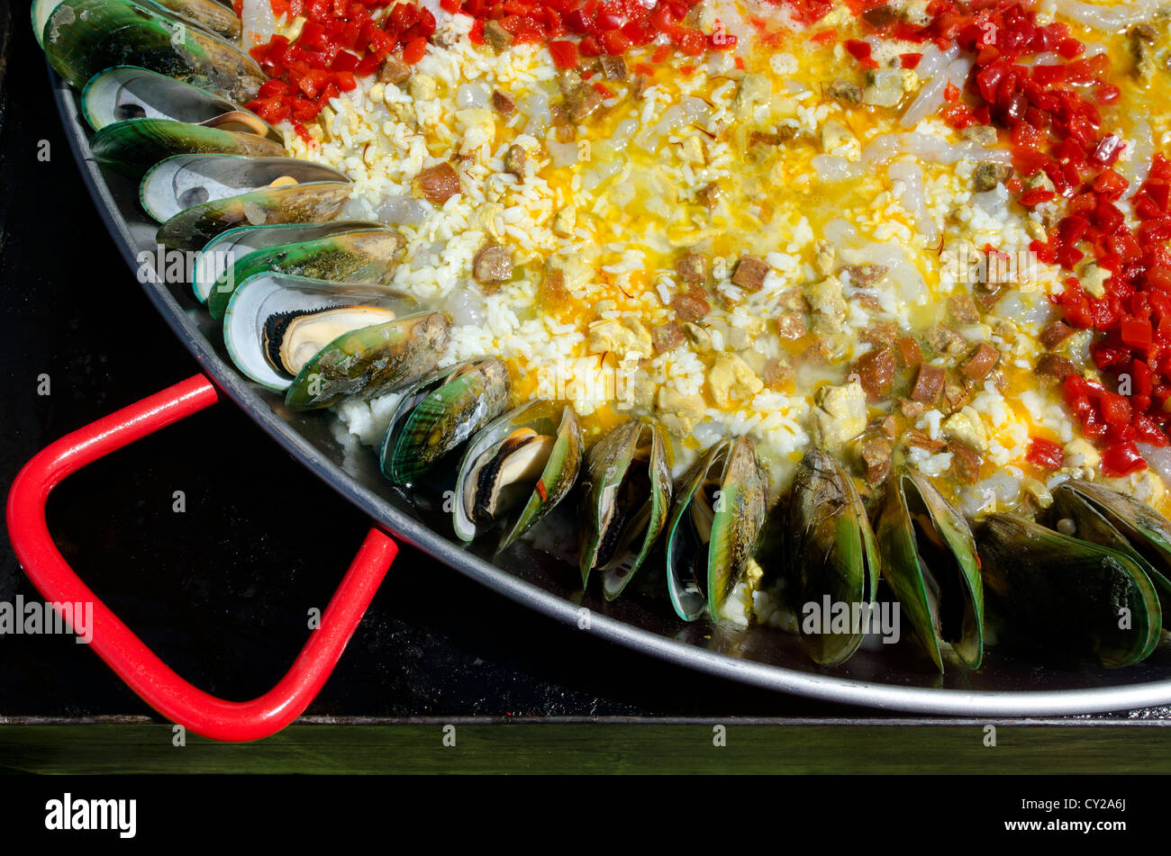 Oysters with vegetables and oriental fried white rice during cooking in a far eastern food restaurant. - Stock Image