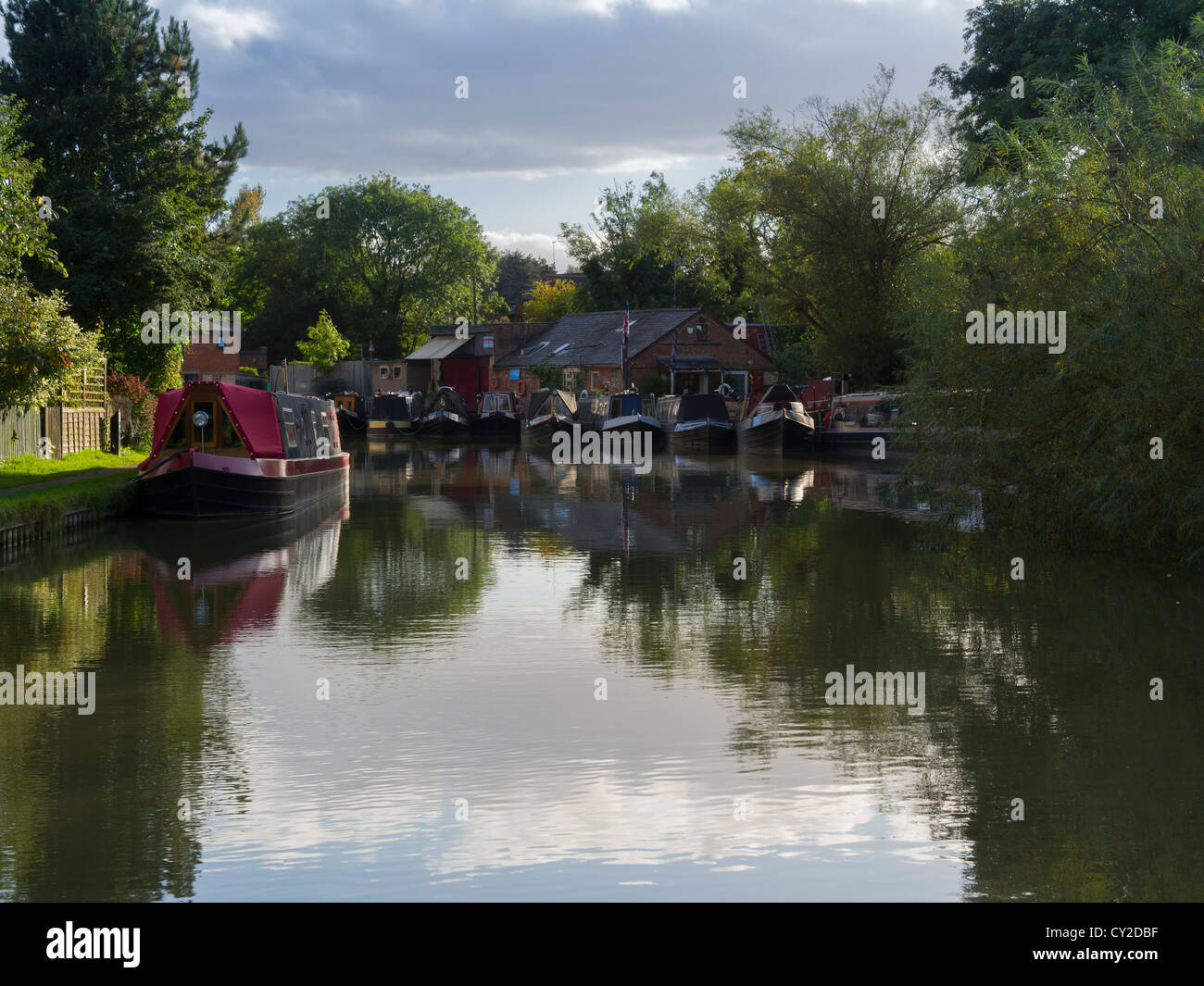 Narrowboats tied up on the Grand Union Canal at Blisworth, Northamptonshire. - Stock Image