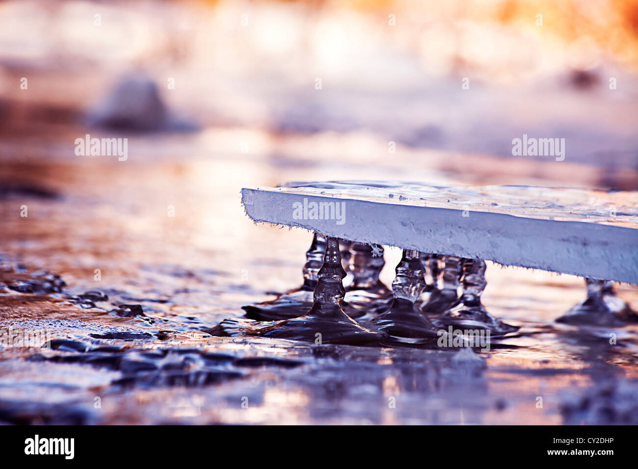 difference in levels on the river seen with ice layer - Stock Image