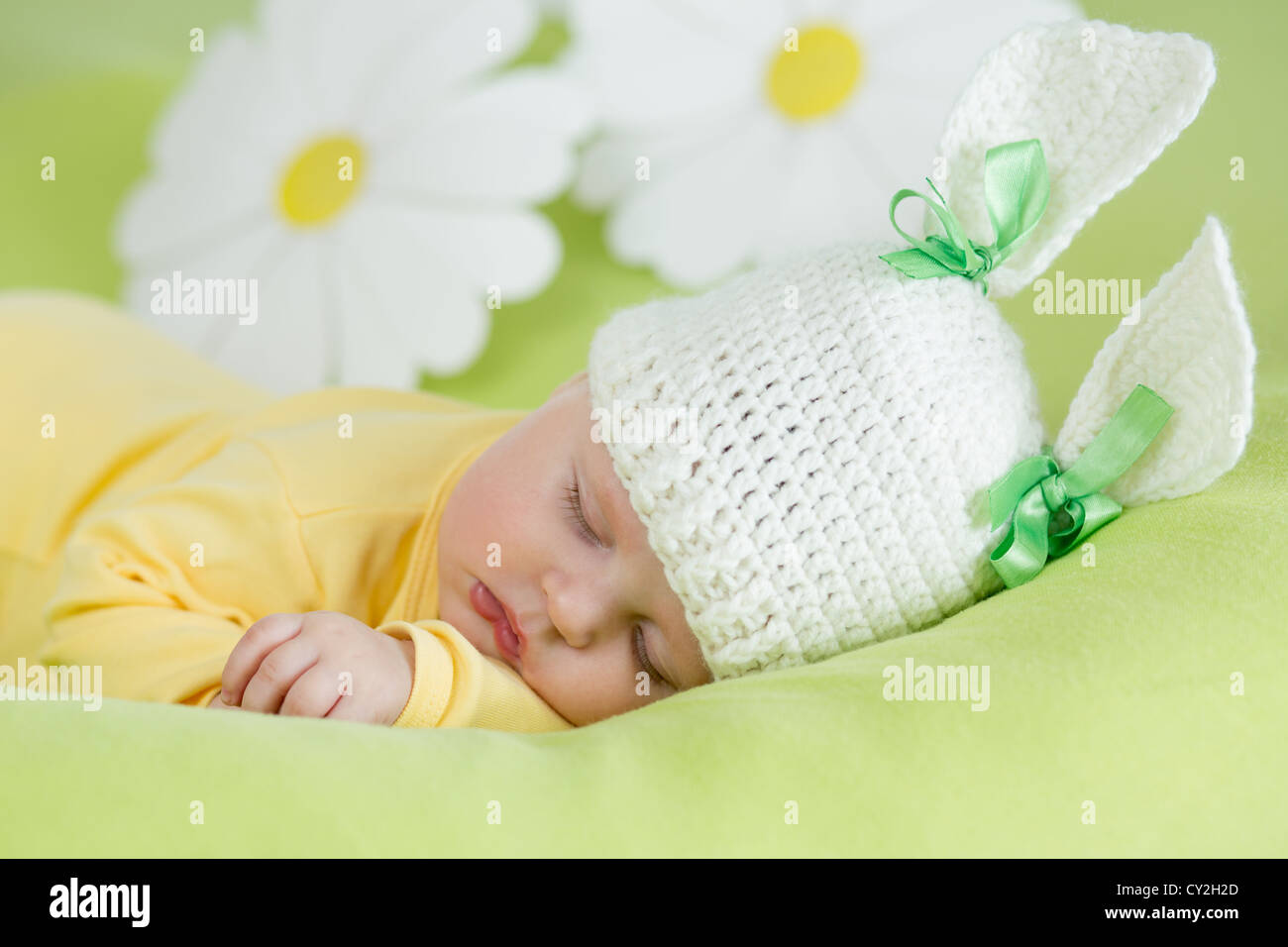 Sleeping Baby In Funny Rabbit Hat On Green Background Stock Photo Alamy