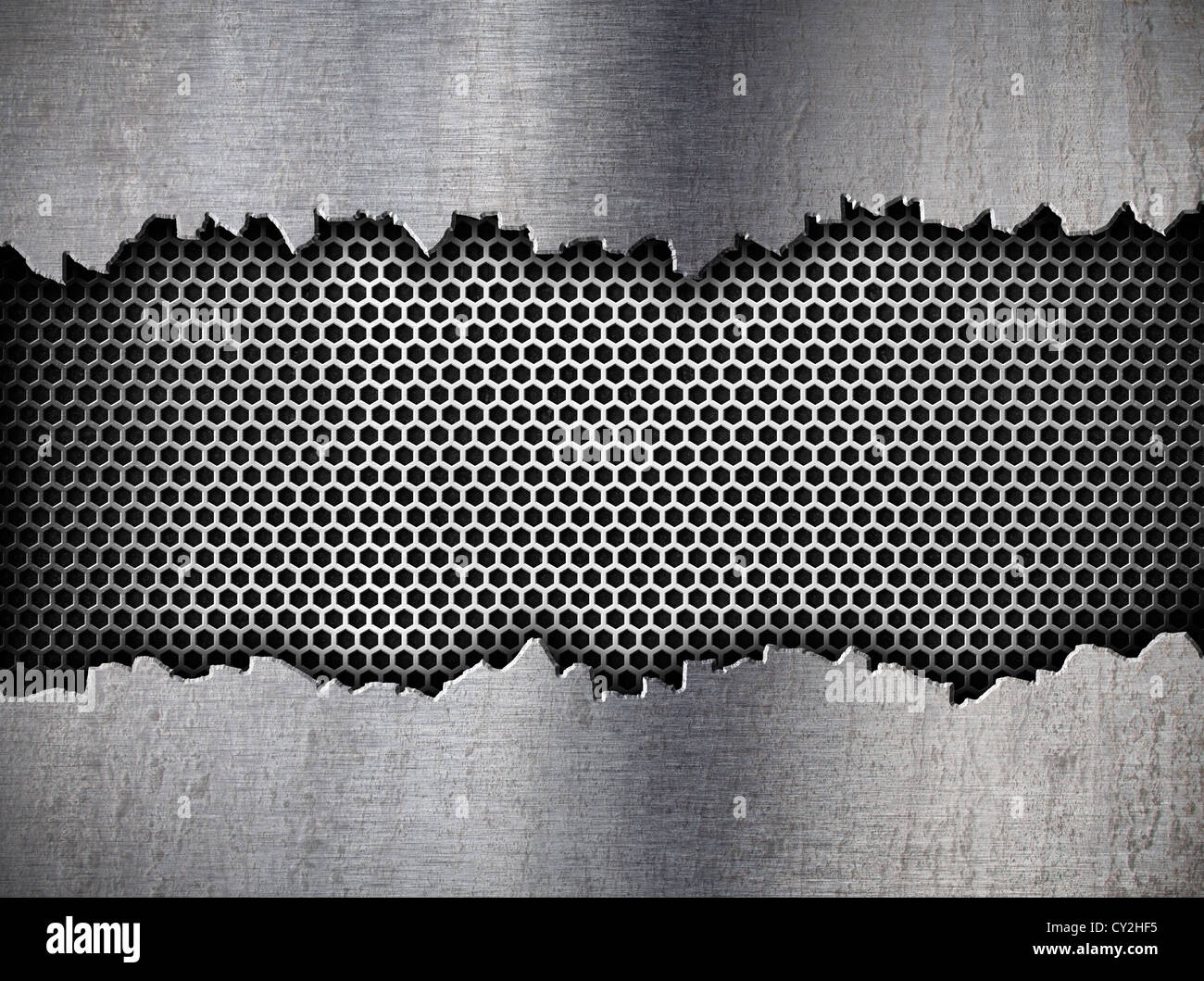 silver hexagon metal grate background in ripped hole - Stock Image