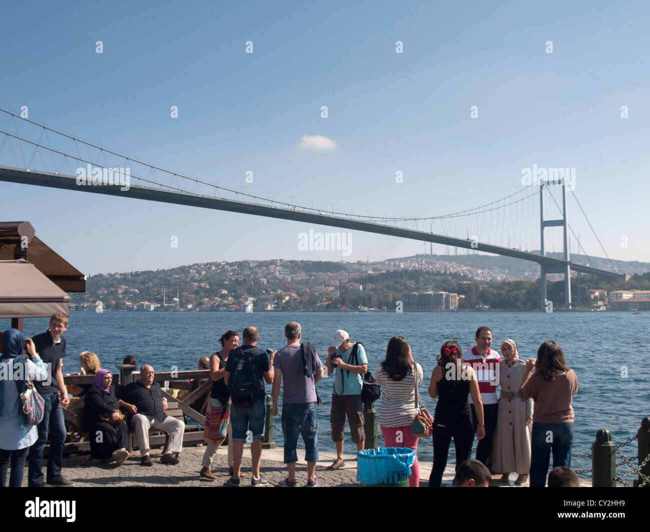 Sunday morning in Ortakoy Istanbul under the Bosphorus bridge, people relaxing enjoying and photographing life and Stock Photo