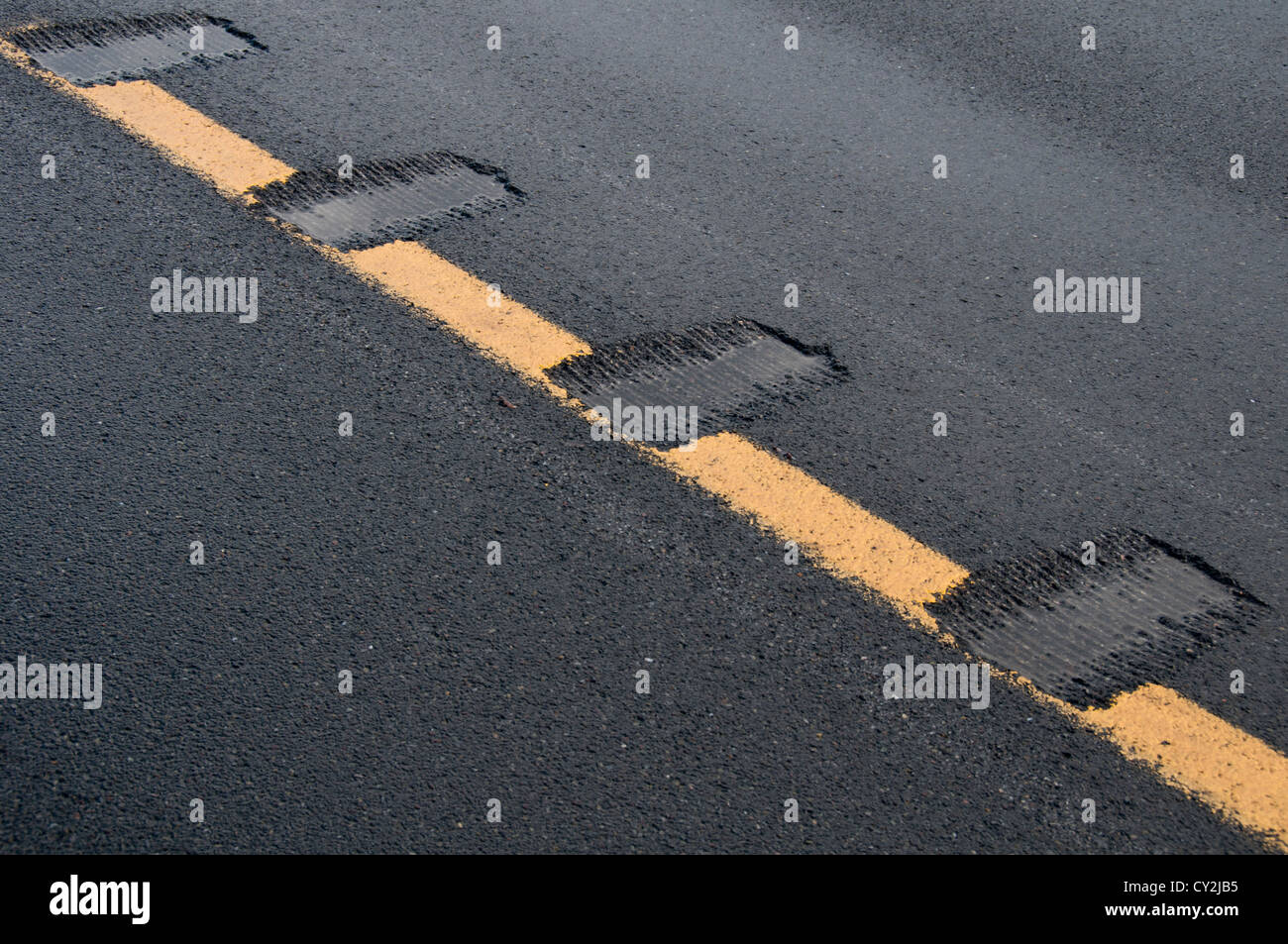 Rumble strips in newly paved road. Stock Photo