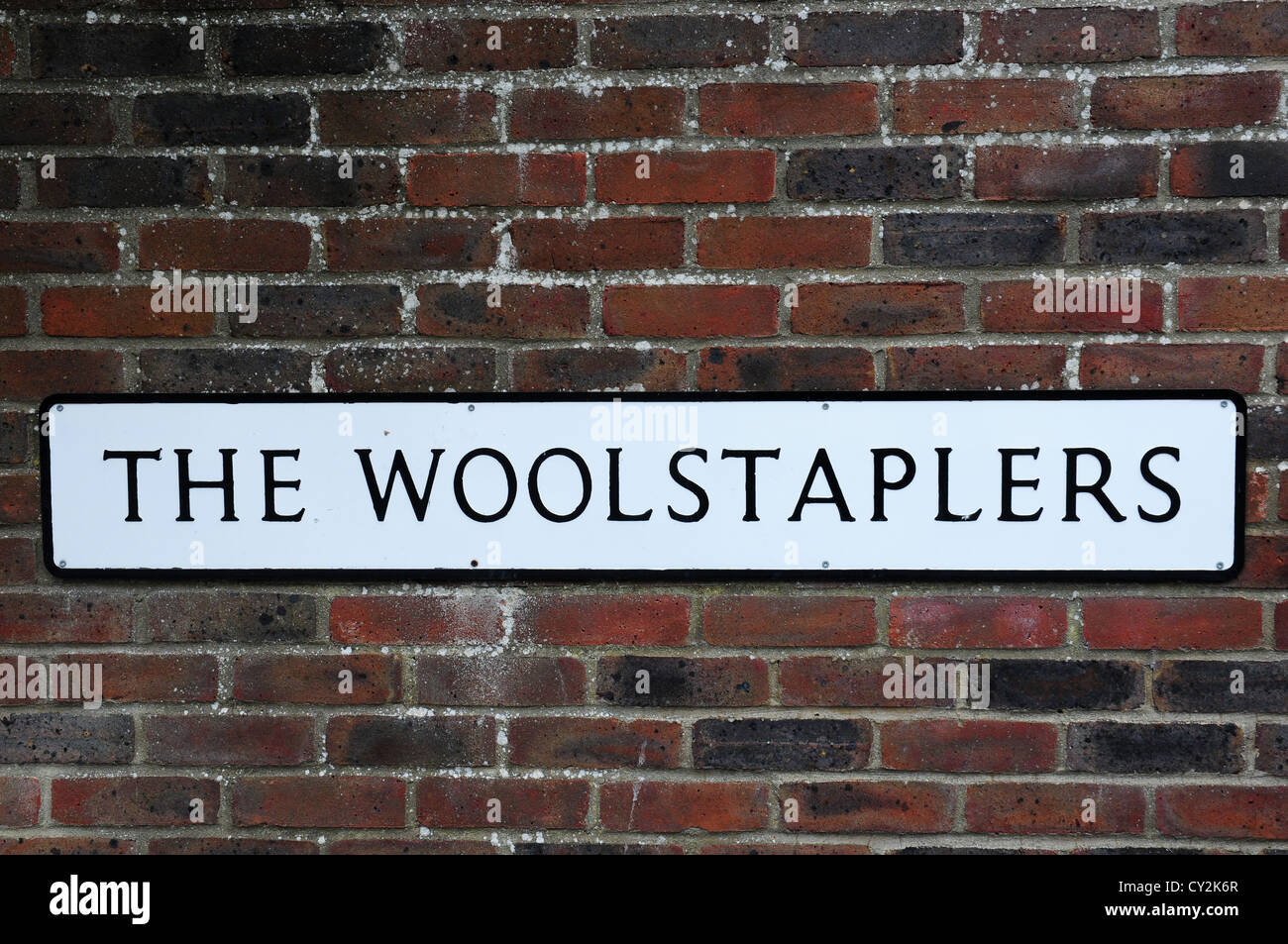 Sign in Chichester reminiscent of Chichester's status as a woolstaple town. - Stock Image